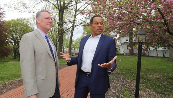 Chad Cianfrani, left, the head of school at the Oakwood Friends School in Poughkeepsie, chats with graduate Juan Williams, a Fox News Channel journalist and political analyst, on the school grounds, May, 2, 2017.