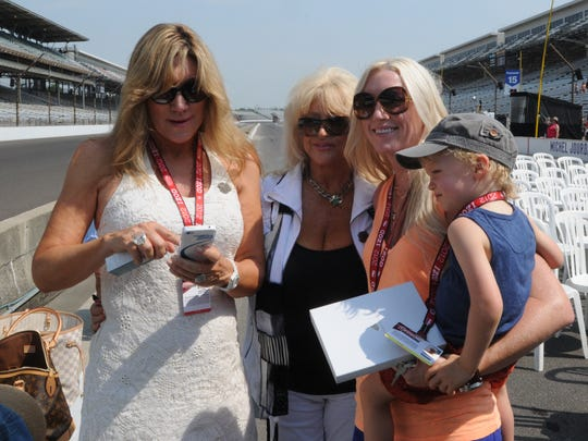 Nancy George (left), Linda Vaughn and Susie Wheldon with son, Sabastian, at the Indianapolis Motor Speedway in 2012.