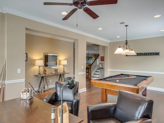 The sellers of the house at 413 Wandering Trail in Franklin used their oversized dining room for both billiards and a home office. At 25 feet by 13 feet, the space is larger than many of the dining rooms you would find in much bigger houses.