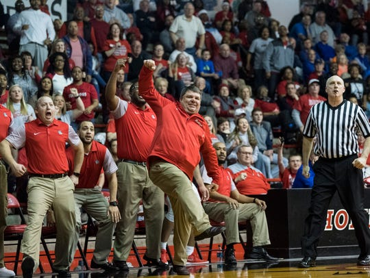 Shane Burkhart shows excitement following a 3-pointer in Bosse's 75-58 win over Greensburg in the Southridge Regional. He was named All-Metro Coach of the Year.
