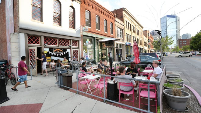People chill out in the outside patio at the Chatterbox on Massachusetts Avenue.