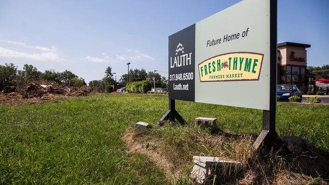 Contractors cleared trees from the future site of Fresh Thyme on McGalliard Road Thursday morning.