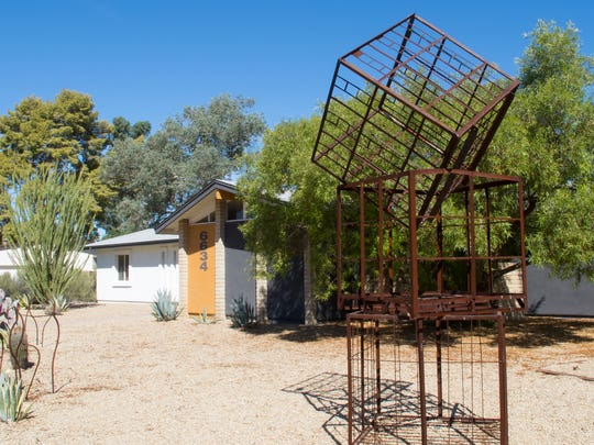 The large metal sculpture in Kuty and Gottlieb's front yard was made from old shipping containers they found at a scrap yard. The couple experimented with several ways of arranging the boxes until they settled on the current configuration.