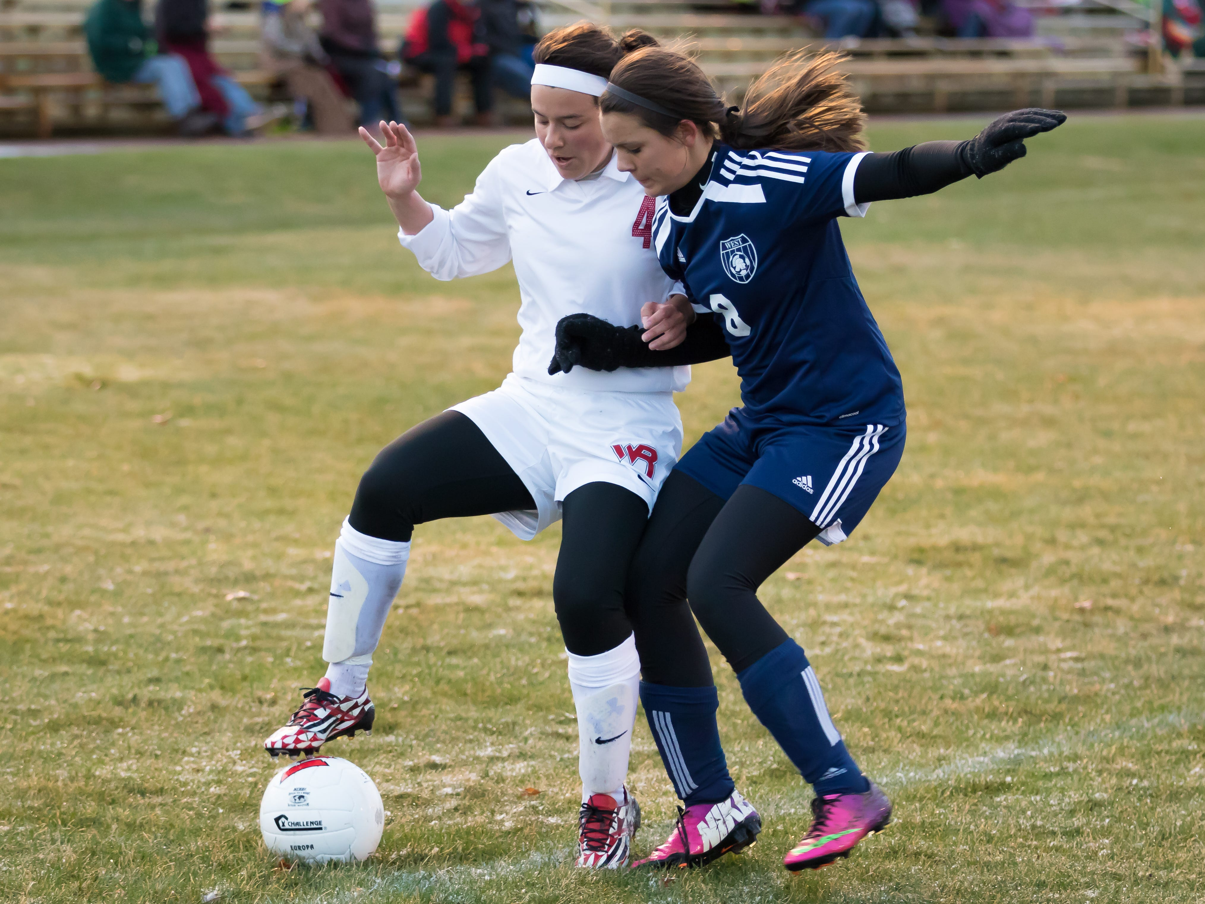 Wisconsin Rapids junior Katie Kiiskila and Wausau West freshman Sydney Draeger battle for the ball during a Wisconsin Valley Conference game Tuesday at Washington Field.