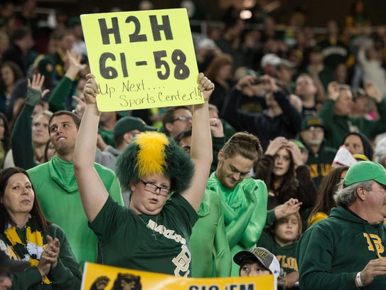 A Baylor fan holds up a sign on Saturday with the October