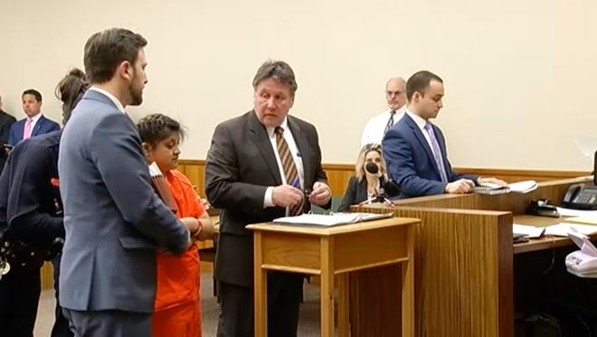 Abigail Hernandez was arraigned on two counts of making a terroristic threat in Monroe County Court.  Hernandez stood between her attorneys Michael Geraci and Clark Zimmermann.