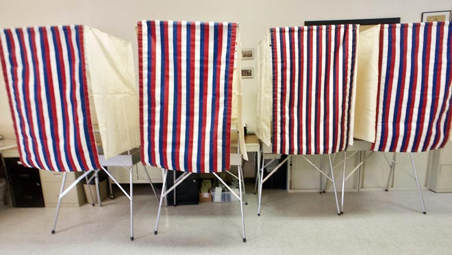 Empty booths await voters in the East Galesburg Village Hall in this Register-Mail file photo.