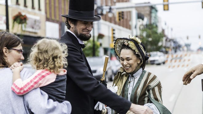 The Lincolns socialize with attendees of the Railroad Days Parade in downtown Galesburg.