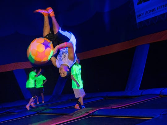 Anthony Cuomo, 15, of Toms River, goes upside down and airborne during a  GLOW session at Sky Zone in Lakewood.