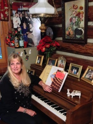 Kathy Wood sits at her Sohmer Centennial Edition upright piano on Aug. 24.