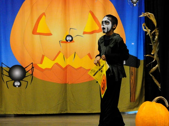 Joshua Martinez of Green Bay trick-or-treats during Sweet Street at Shopko Hall on Friday.