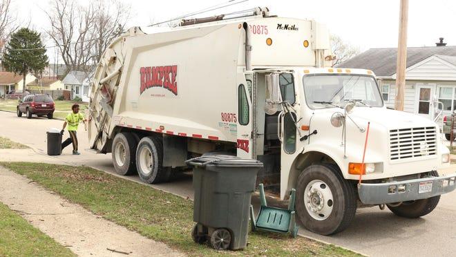 Rumpke driver Jeff Jenkins hustles on his Colerain Township trash route.