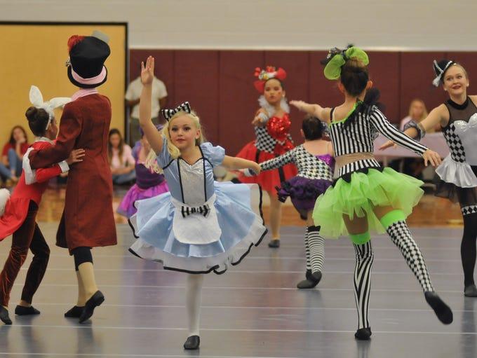 "Members of Heather's Dance Studio perform ""Alice at"