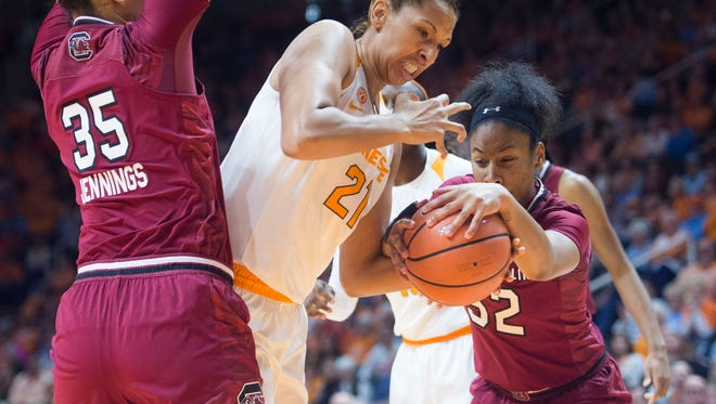 Tennessee's Mercedes Russell tries to keep the ball from South Carolina's Tyasha Harris. Also defending Russell is South Carolina's Alexis Jennings, left.