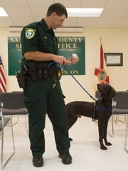 Santa Rosa County Sheriff's Office Deputy Robert Lenzo shows off Kilo, his new K-9, on Monday. Kilo is training to detect and find contraband at the Santa Rosa County Jail.