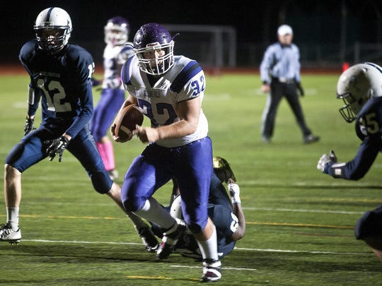 Bellows Falls fullback Jacob Lober, center, runs into the end zone for a touchdown against Burlington in 2015.