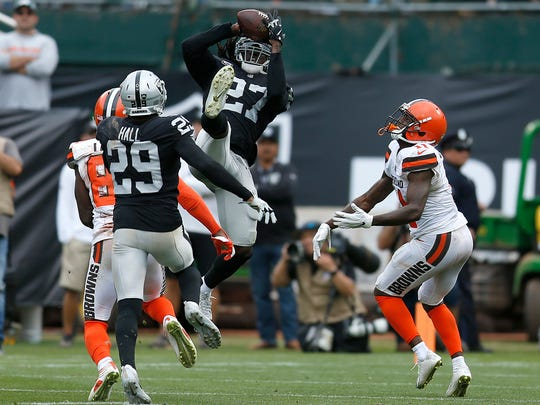 Oakland Raiders defensive back Reggie Nelson (27) intercepts a pass by Cleveland Browns quarterback Baker Mayfield during the 2018 season.