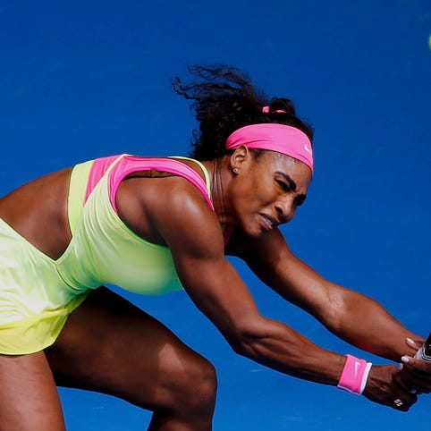 Serena Williams of the U.S. stretches to hit a return to Garbine Muguruza of Spain during their women's singles fourth round match.