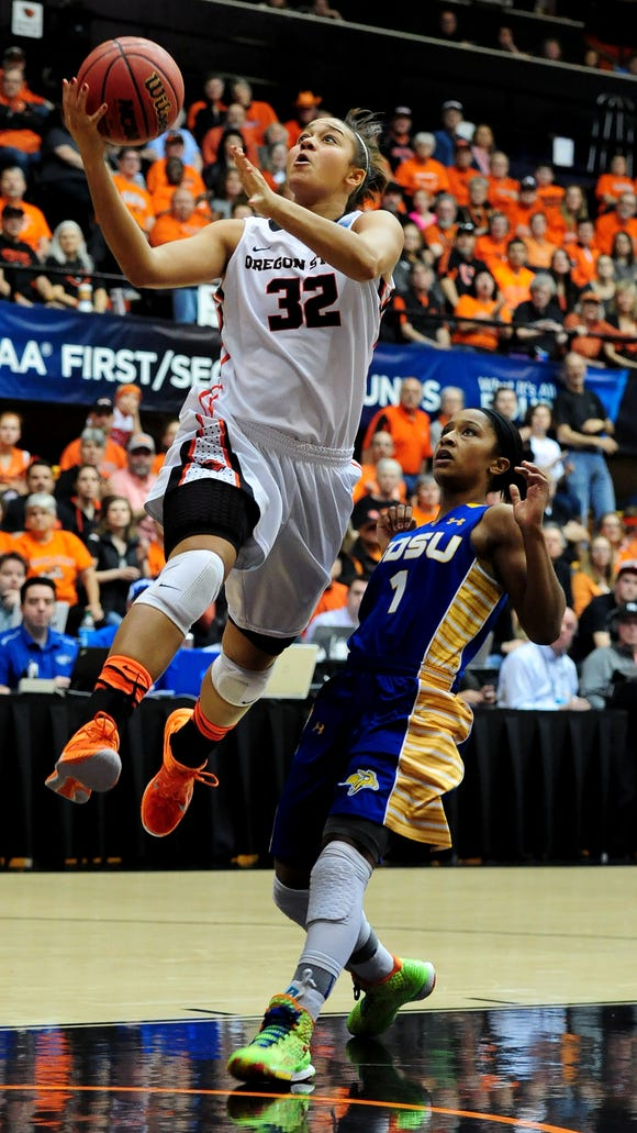 Oregon State forward Deven Hunter continues to the basket after being fouled by South Dakota State guard Alexis Alexander during the first round of  the NCAA Women's Basketball tournament first round at Gill Coliseum, on Friday, March 20, 2015, in Corvallis. OSU won the game 74-62.