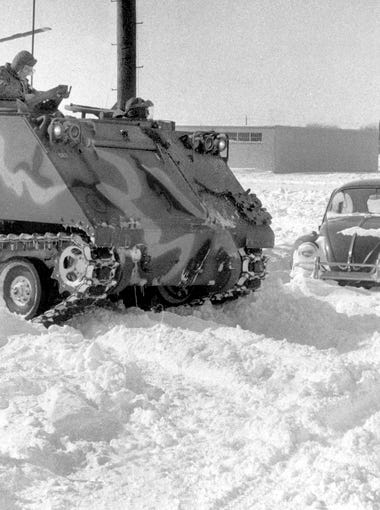 A National Guard armored personnel carrier was one of few vehicles to get out on the streets 25 years ago this weekend as the Blizzard of 1978 left Indianapolis buried in more than 20 inches of snow -- more than 15 inches of freshly fallen powder capped about 5 inches that already was on the ground from the previous weekend. For three days, from Jan. 25 to Jan. 27, snow fell, the winds blew, and temperatures plummeted. Snow drifted as high as 10 feet and National Guardsmen were called out to rescue many stranded motorists all over Indiana and to break through snowdrifts on Interstate 465. More than 300 travelers - most of them passengers on northbound and westbound Greyhound buses - were stranded at the Downtown terminal. On Thursday, Jan. 26, Mayor William Hudnutt declared a snow emergency following a statewide emergency declared by Gov. Otis Bowen. Hudnut was awake for 36 straight hours as he coordinated the city's response to the snow emergency, including time spent in a helicopter hovering over the strangely quiet, pure white cityscape. Finally, on Sunday, main roads in Indianapolis were clear enough to navigate. Ultimately, 11 deaths in Indiana were attributed to the Blizzard of '78. Indianapolis Star File Photo