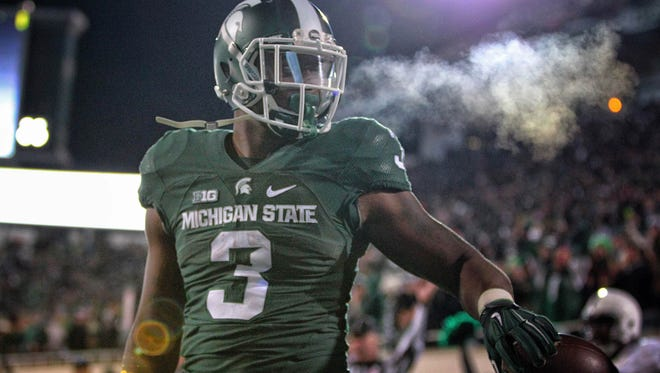 Running back LJ Scott is one of several young players, formerly heralded recruits, helping push MSU to the next level.