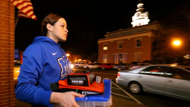 MTSU womens basketball player TiAnna Porter helps move ballots and other election items back to the Rutherford County Election Commission Office on Election Day March 1, 2016.