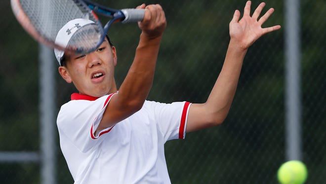 Harry Lee of West Lafayette with a return to Jake Weber of Harrison at No. 3 singles Thursday, August 17, 2017, at Harrison High School. Lee won 6-1, 6-1. West Lafayette won the match 4-1.