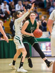 Rice Memorial's Kristen Varin, right, tries to get around St. Johnsbury's Kayla Matte in Burlington on Wednesday, March 7, 2018.