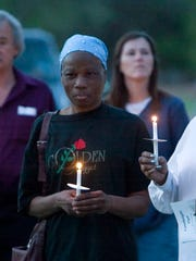 Linda Blueford, left, and Debra Collins held candles at a 2007 candlelight vigil for Maurice Green.
