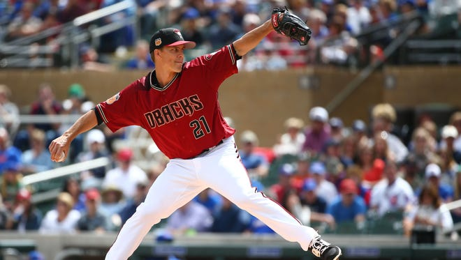 Arizona Diamondbacks pitcher Zack Greinke throws to the Chicago Cubs in the 1st inning during spring training action on Mar. 23, 2017 at Salt River Fields in Scottsdale, Ariz.
