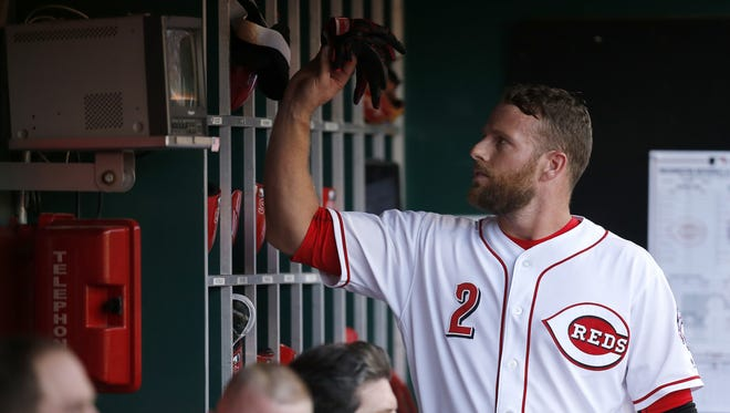 Cincinnati Reds shortstop Zack Cozart (2) returns to the dugout after hitting into a double play in the bottom of the first inning during the game between the Cincinnati Reds and the Washington Nationals at Great American Ball Park on July 14, 2017.