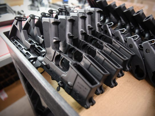 AR-15 parts are stacked for assembly at Alex Pro Firearms