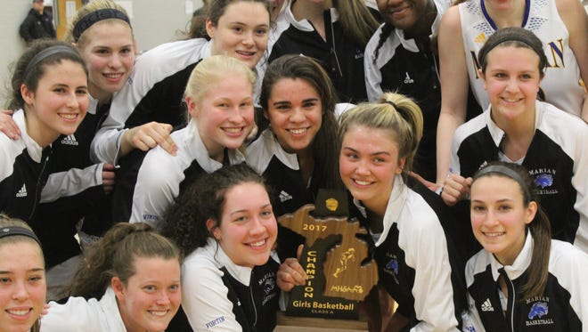 Marian captured its sixth straight district championship Friday with a 47-45 victory over Bloomfield Hills.