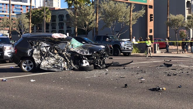 The wreckage of a vehicle that was struck head on by another driver fleeing from police on Jan. 24, 2018. The collision occurred on Rural Road just south of Apache Boulevard in Tempe.