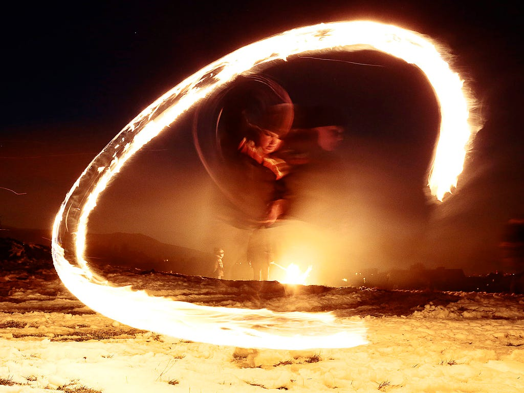 A child twirls a ball of fire to ward off evil spirits during a ritual Shrovetide celebration on Feb. 15 in Lozen village, Bulgaria.