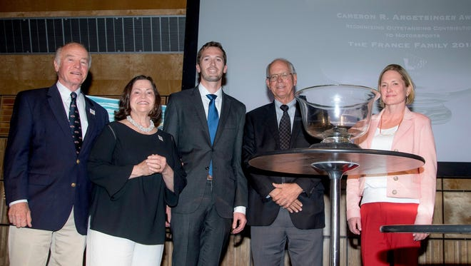 J.C. Argetsinger and his sister, Louise Argetsinger Kanaley, present the Cameron R. Argetsinger Award to three generations of the France Family: Ben Kennedy, Jim France and Lesa France Kennedy.