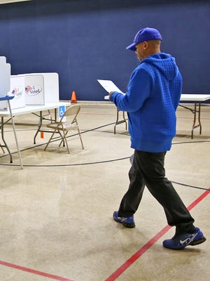Cory Lynch took his ballot to cast on Election Day at the Thomas D. Gregg School 15 polling site Tuesday, Nov. 3, 2015.
