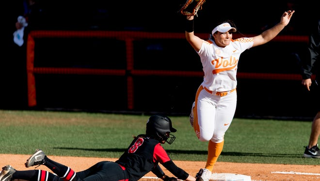 Tennessee first baseman Ashley Morgan (7) outs Georgia infielder Alyssa Dicarlo (8) at first during a game between Tennessee and Georgia at Sherri Parker Lee Stadium in Knoxville, Tennessee on Saturday, March 31, 2018.