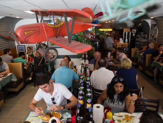 People enjoy their meals during a packed lunchtime at Brooks Gourmet Burgers & Dogs in Naples, Florida on Friday, Sept. 16, 2016.