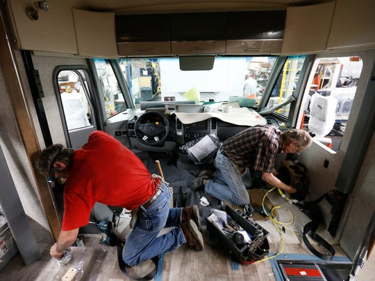 John Haugen of Thompson, Iowa (left), and Larry Schuchhardt of Hayfield, Iowa, help build out the interior of a Winnebago Via Wednesday, Nov. 16, 2016, at the Winnebago Industries manufacturing plant in Forest City, Iowa.