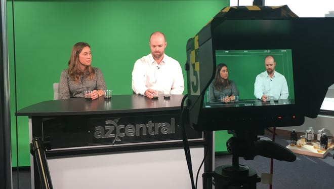 Katie Vanyo (left) and Matt Ridens taste Arizona craft beers in azcentral's video studio to determine which was made with recycled water.