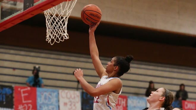 Evina Westbrook scores as the Saxons take on West Salem in the second round of the OSAA Class 6A state playoffs on Saturday, March 4, 2017, at South Salem High School.