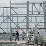 Workers construct modules to be used at an oil refinery Thursday afternoon at the Port of Iberia. By Leslie Westbrook July 16, 2009