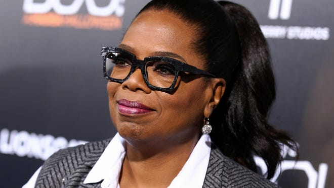 """FILE - In this Oct. 17, 2016 file photo, Oprah Winfrey attends the world premiere of """"BOO! A Madea Halloween"""" in Los Angeles. Winfrey has agreed to give commencement speeches at colleges in Massachusetts and New York. (Photo by John Salangsang/Invision/AP, File)"""