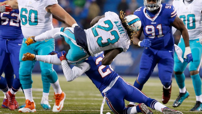 Dolphins running back Jay Ajayi carried a season-high 32 times for 206 yards in Week 16's overtime win at Buffalo.