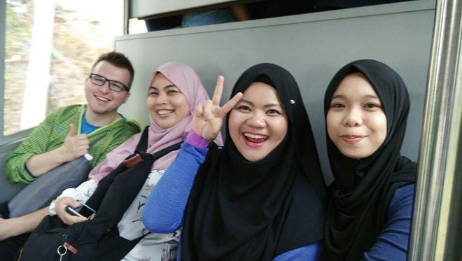 Mackenzie McMillan with friendly Malaysian women who offered sightseeing tips.