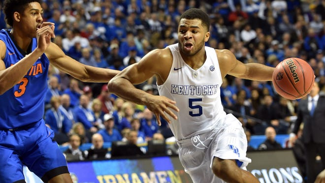 Kentucky guard Andrew Harrison drives against Florida forward Devin Robinson during the first half of their SEC tournament quarterfinal on Friday.