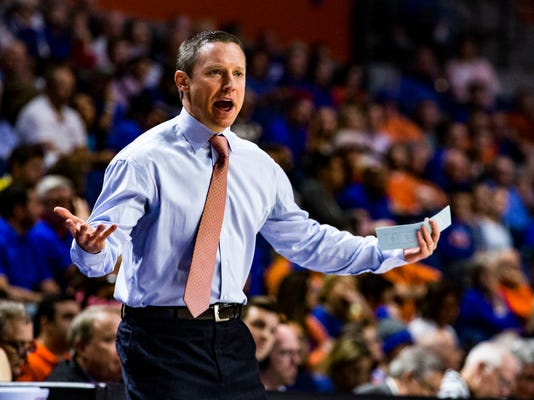 Florida coach Mike White yells at the team during the first half of an NCAA college basketball game against Georgia in Gainesville, Fla., Wednesday, Feb. 14, 2018. (Lauren Bacho/The Gainesville Sun via AP)