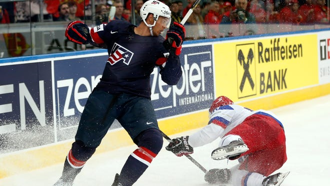 Team USA defenseman Seth Jones, left, of the Nashville is getting a preview of his new coach at the World Championships.