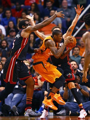 Phoenix Suns guard Archie Goodwin (center) drives to the basket against the Miami Heat at Talking Stick Resort Arena. The Heat defeated the Suns 103-95.